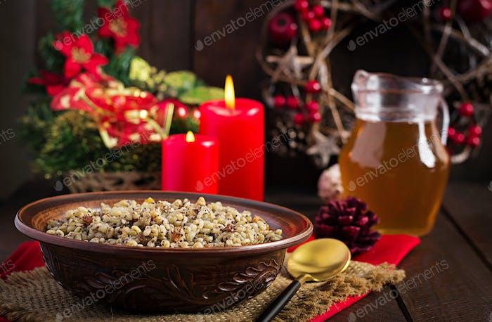 Christmas porridge made of wheat grains, poppy seed, nuts, raisins