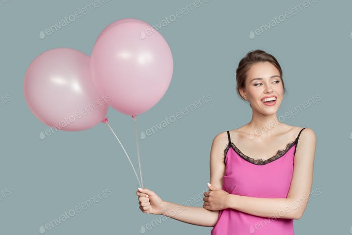 Portrait Of Smiling Woman. Holding Pink Balloons In Her Hand.