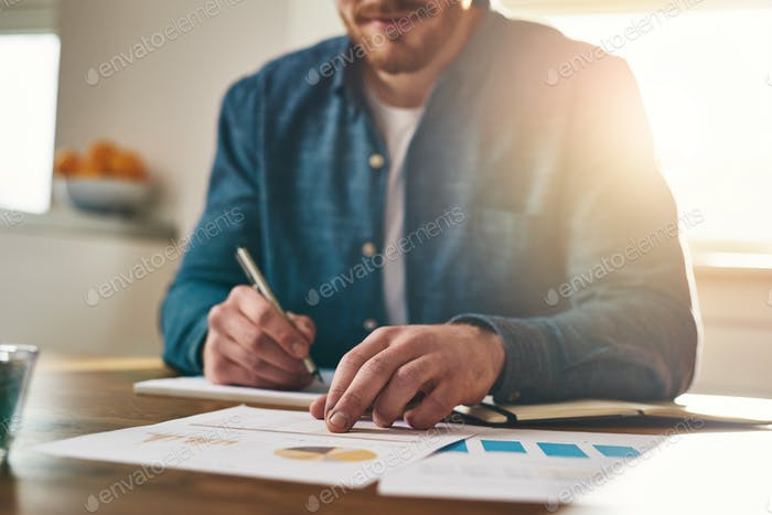 Businessman analysing statistical charts