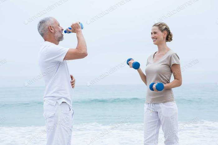 Fit couple doing sport at the beach