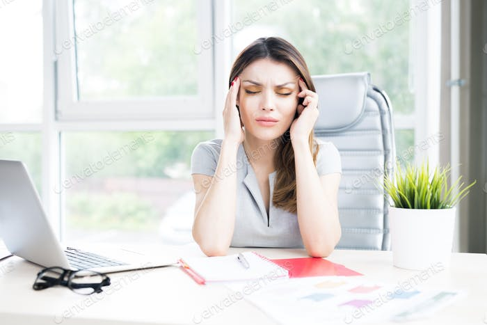 Modern Businesswoman Suffering from Headache