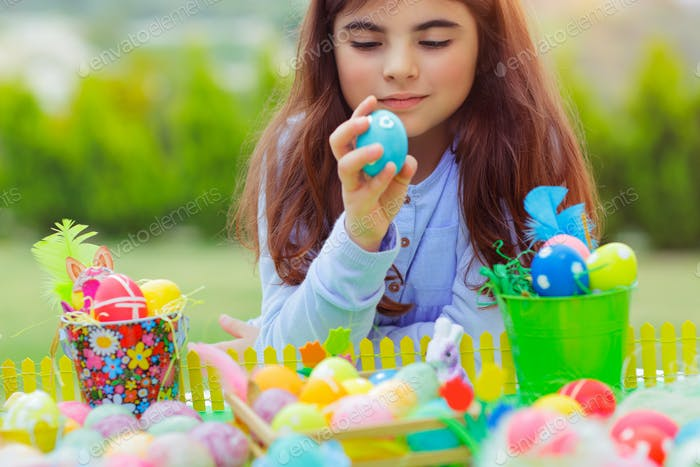 Little girl playing with Easter eggs