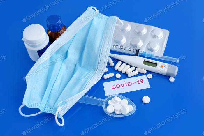 Medical protective mask with pills, thermometer, medicines, syringes