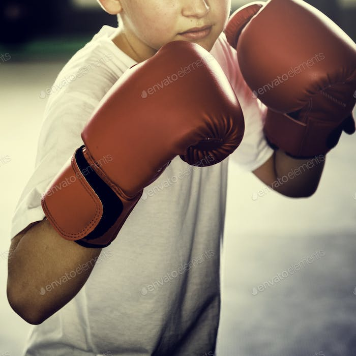 Boy Boxing Training Gym Punching Concept