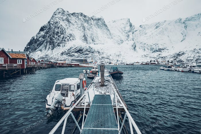 Pier with boats in Reine, Norway