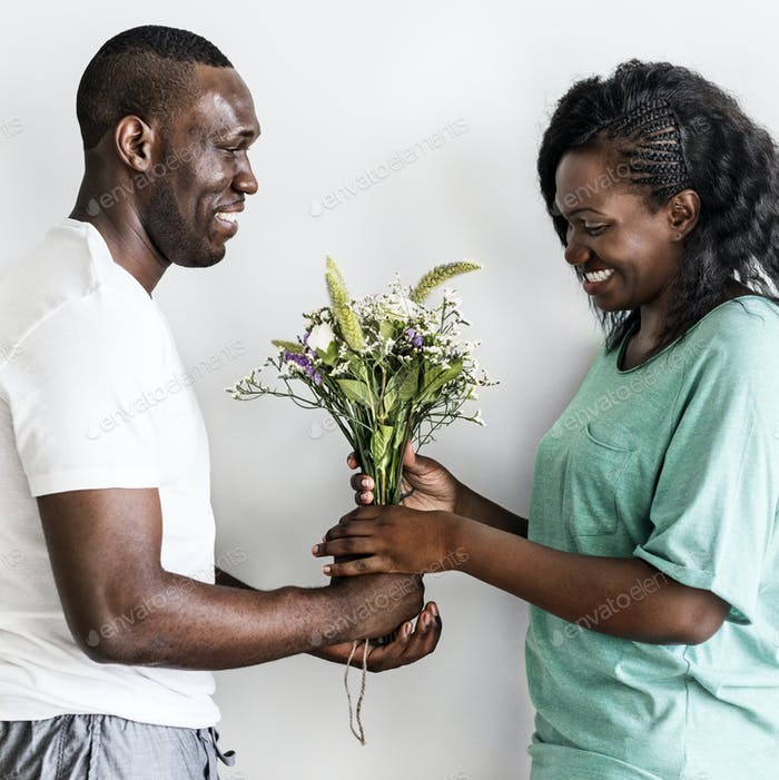 Wife receives a bouquet of flowers from her husband