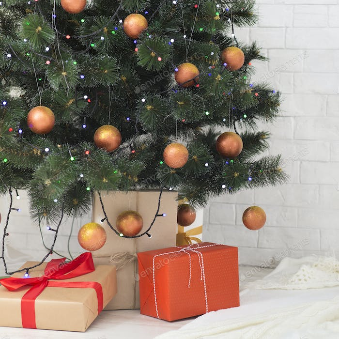 Decorated Christmas tree with lots of gifts