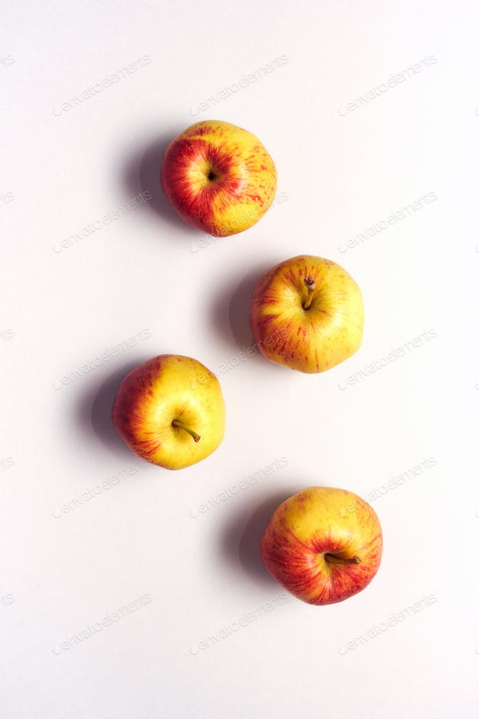 Overhead View Of Fresh Apples Against White Background
