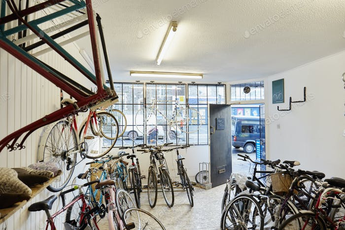 A bicycle shop, stocked with sports bikes, mountain and road bicycles.