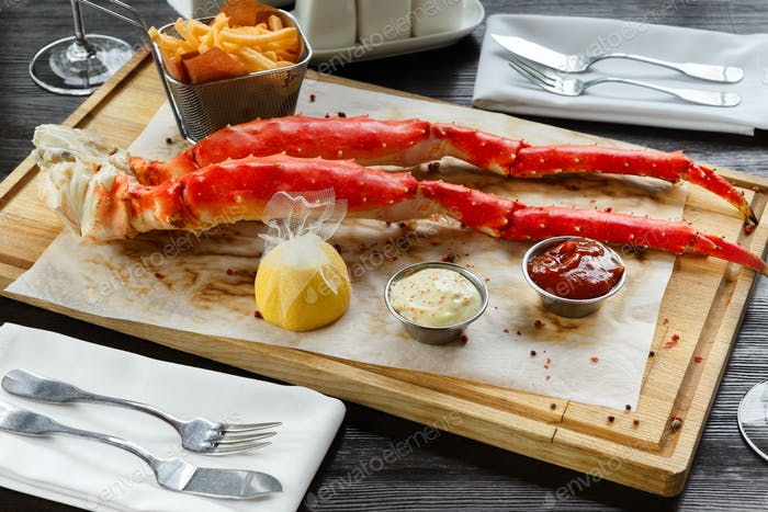 Romantic dinner with king crab legs in restaurant
