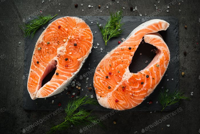 Raw salmon steak with food ingredients