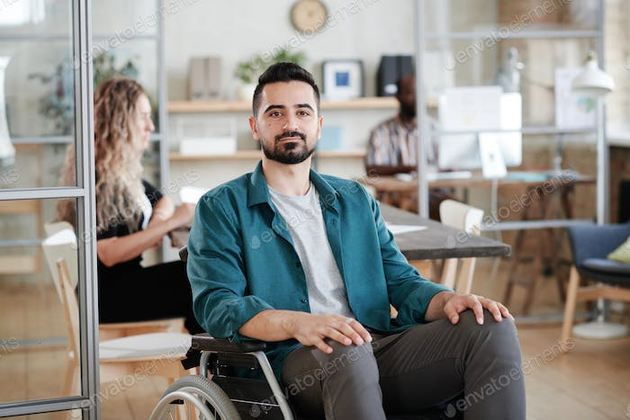 Disabled office worker working at office
