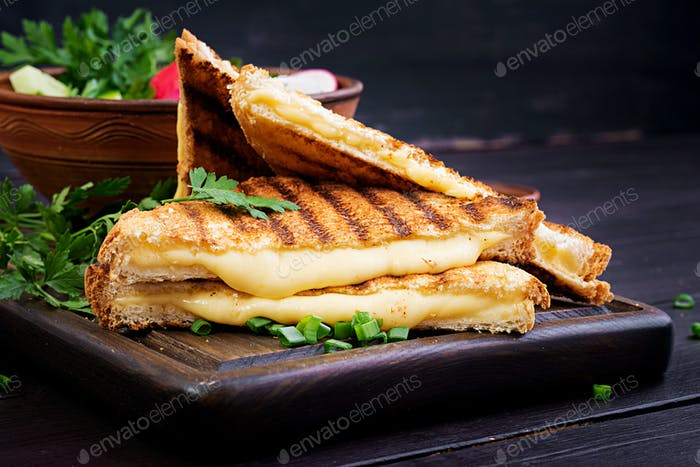 American hot cheese sandwich. Homemade grilled cheese sandwich for breakfast.