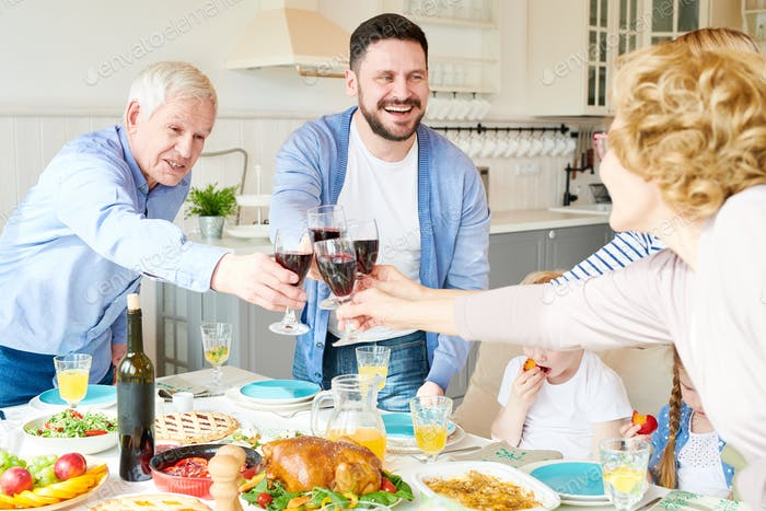 Big Family Toasting at Dinner Party