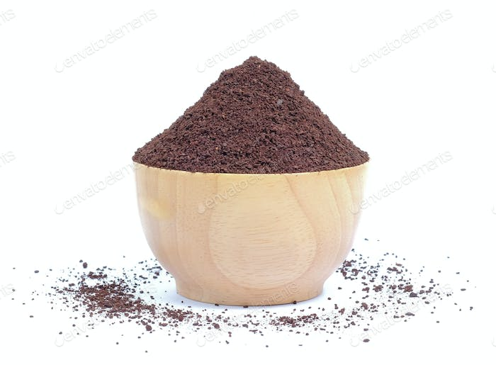 Fresh coffee powder in wood bowl on white background.