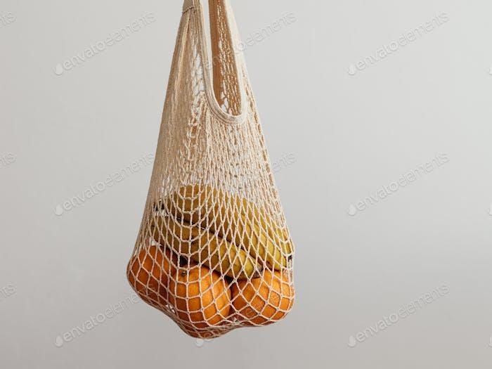 woman hand hold mesh bag. Zero waste concept