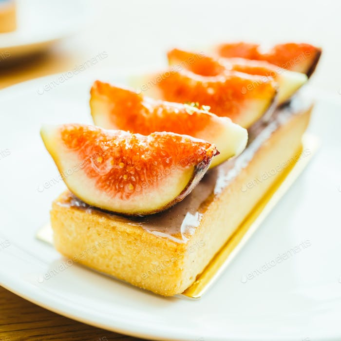 Sweet dessert with tart and fig on top
