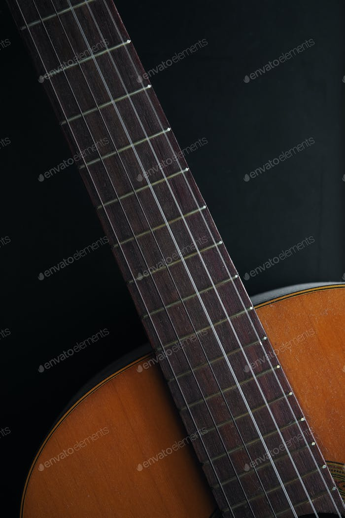 Close-up neck and upper bout of acoustic guitar