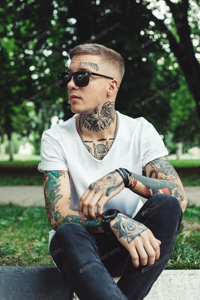 Stylish young man with tattoos