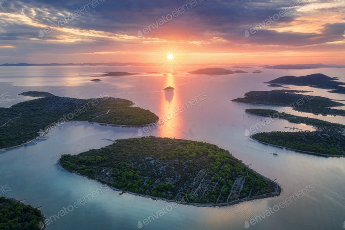 Aerial view of beautiful small islands in Adriatic sea at sunset