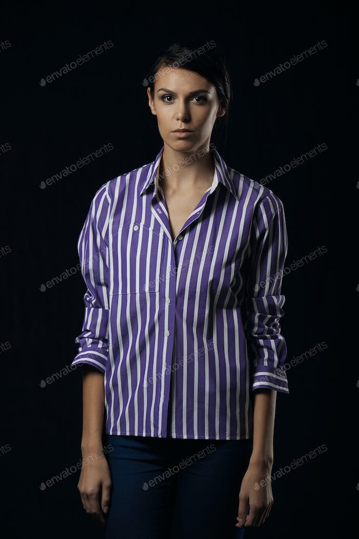 Fashion photo of young magnificent woman in purple shirt
