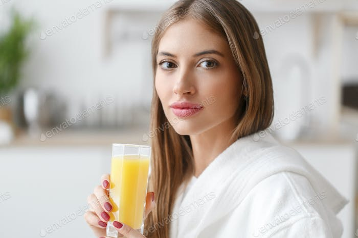 Woman kitchen portrait with fruits and juice