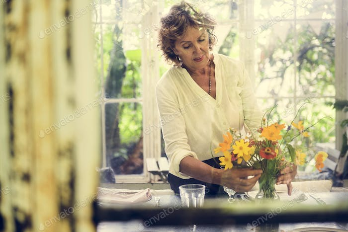 Woman arranging flowers
