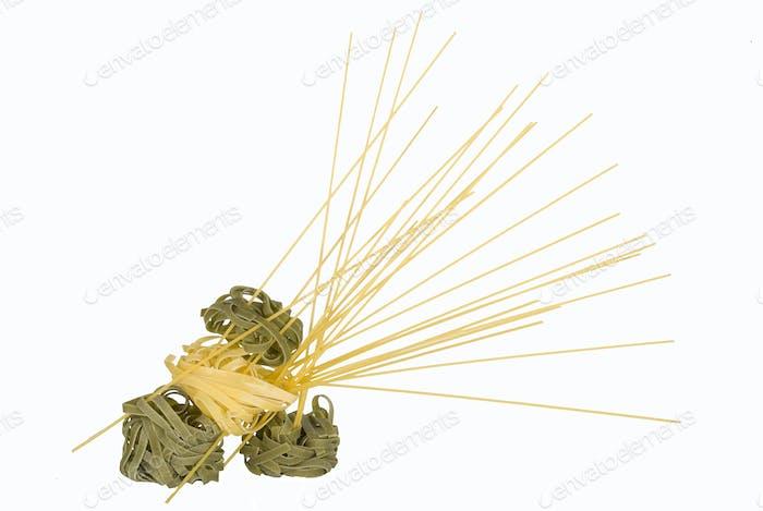 Tagliatelle and spaghetti (spagettine) isolated.