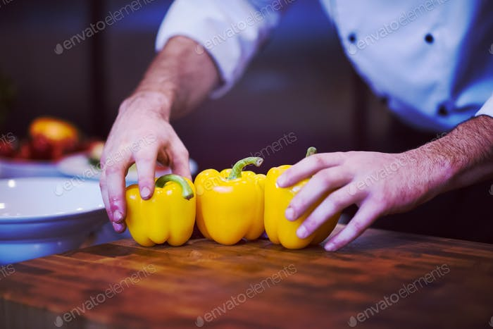 chef holding fresh peppers