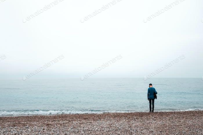 Alone boy stay near sea