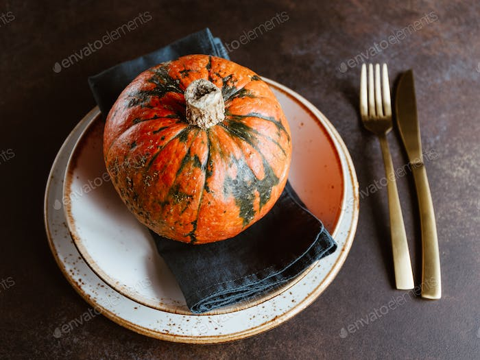 Small pumpkin on a served plate on a table
