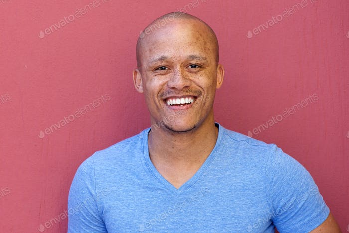handsome african american man smiling against red background