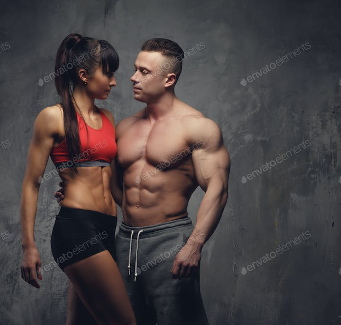 Shirtless bodybuilder and fitness woman in sportswear.
