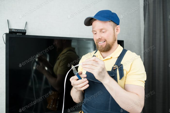 Cheerful guy cutting wire