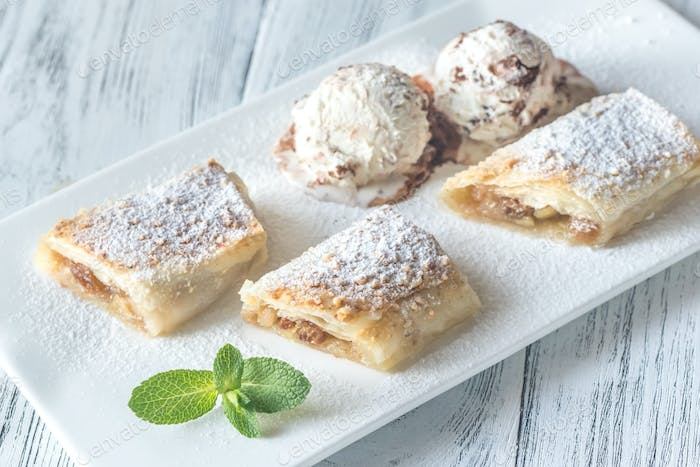 Slices of apple strudel on the white plate
