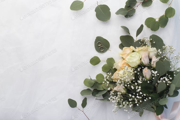 Wedding bouquet of beautiful cream roses on white background
