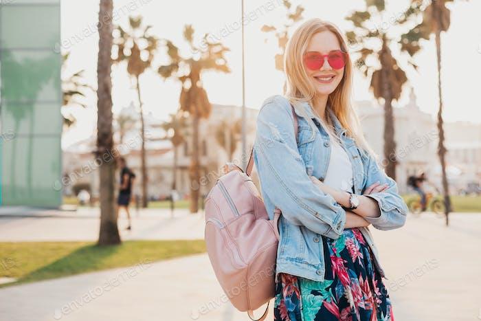 pretty smiling woman walking in city street