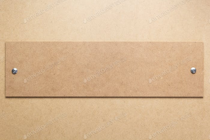 wooden and fiber board background  with screws