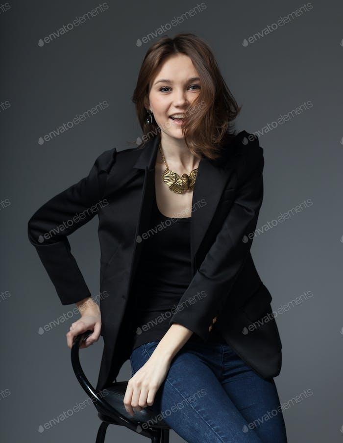 young woman in black blaazer