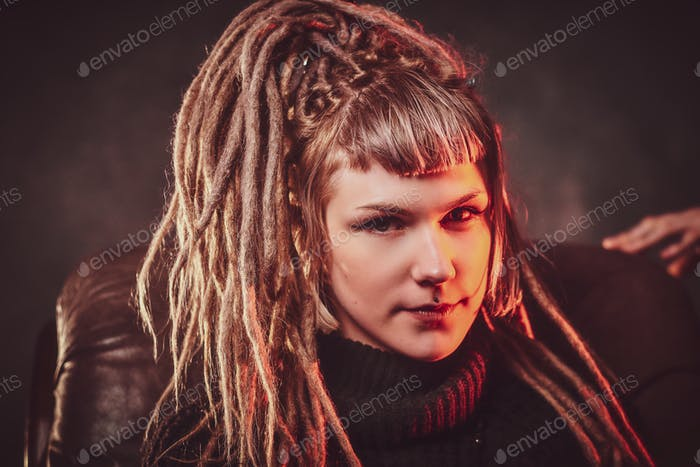 Young attractive woman with dreadlocks