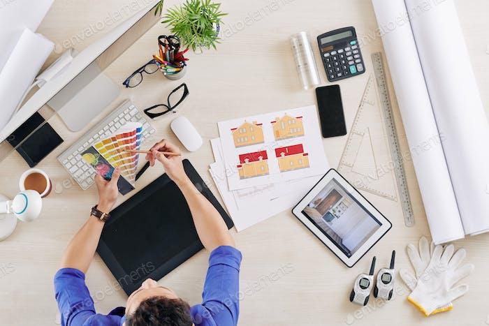 Interior designer choosing color scheme