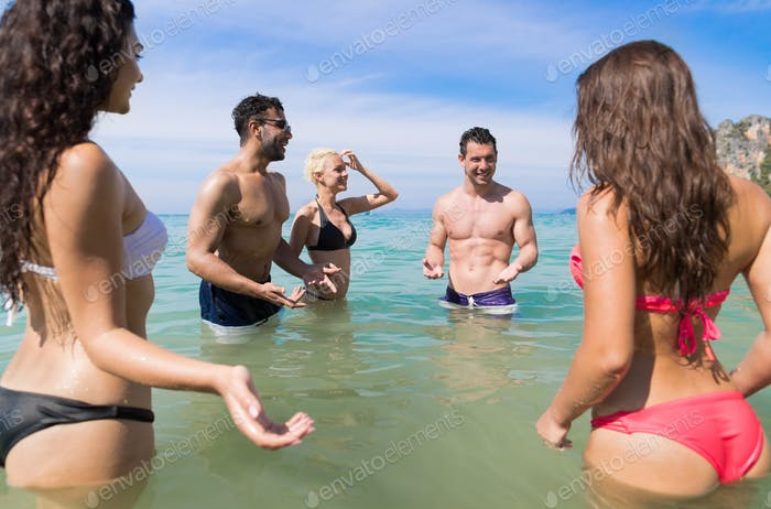 Young People Group On Beach Summer Vacation, Happy Smiling Friends In Water Sea Ocean