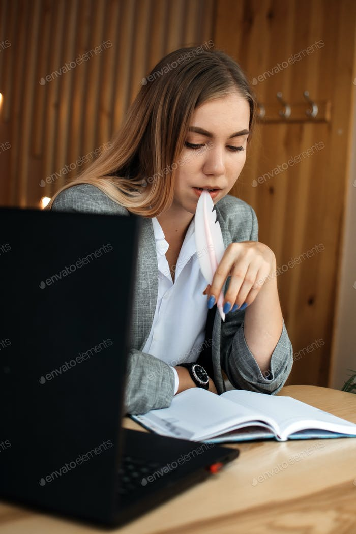 Copywriter, content creator, Remote Copywriting. Young woman freelancer typing on keyboard using
