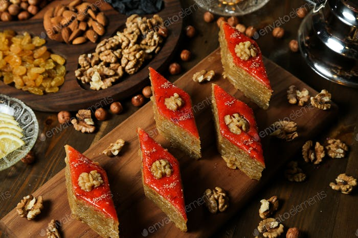 top view traditional azerbaijani baklava with walnuts on a stand