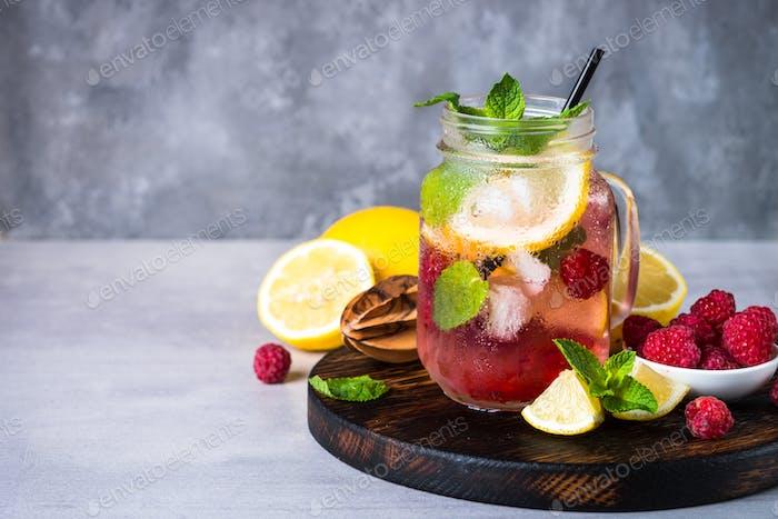 Raspberry lemonade in mason jar.