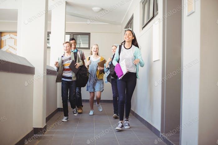 Group of classmate running in corridor