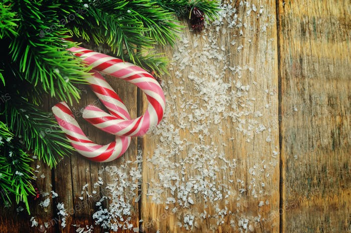 Wood dark Christmas background with Christmas tree and candy