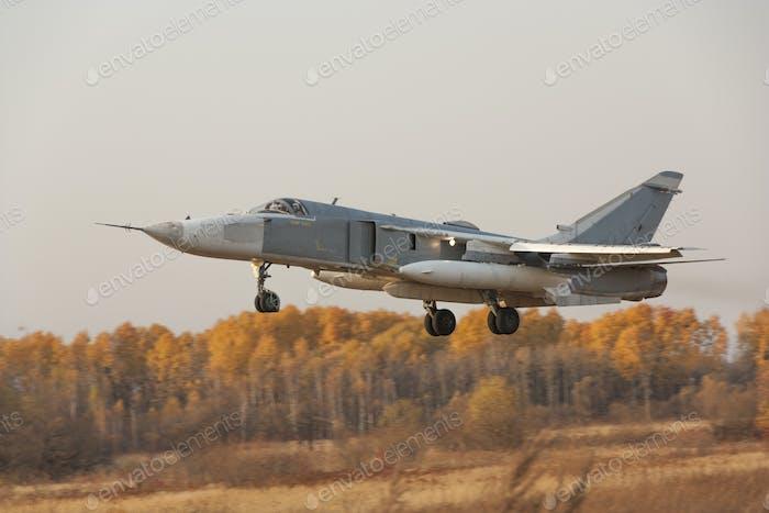 Military jet bomber Su-24 Fencer flying