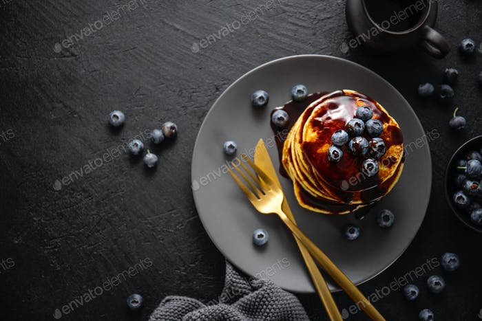 Tasty homemade pancakes with sauce and berries