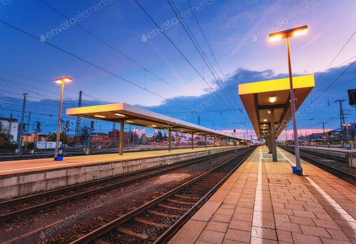 Beautiful night industrial landscape, modern railway station